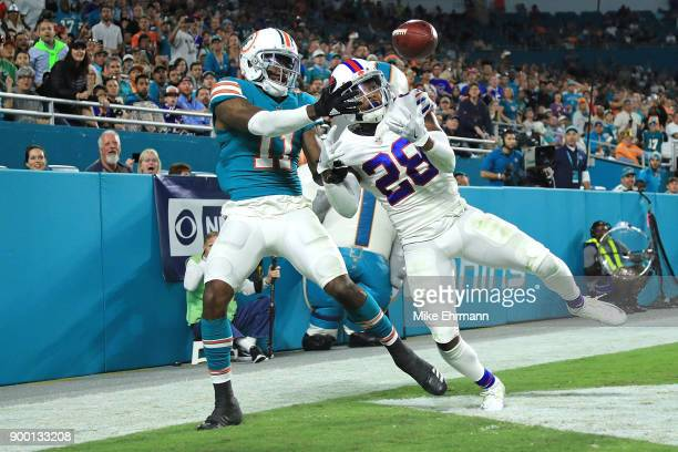 J Gaines of the Buffalo Bills deflects the pass during the fourth quarter against the Miami Dolphins at Hard Rock Stadium on December 31 2017 in...