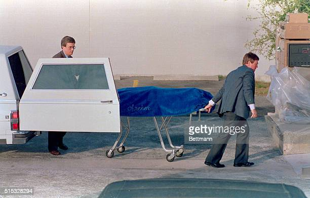 The body of Theodore Ted Bundy is taken to the Alachua County Medical Examiner's office following his execution at 716 am Bundy was executed for the...