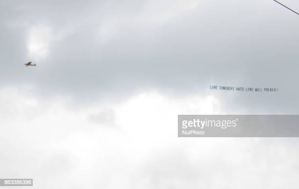 Gainesville October 18 2017 An airplane tows a banner protesting Richard Spencer at the University of Florida in Gainesville Florida United States on...