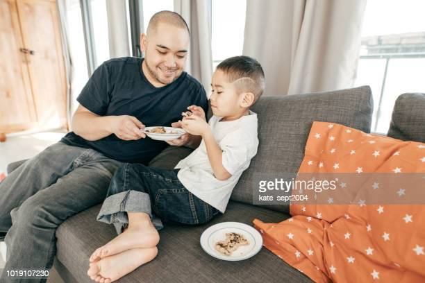 gaining weight on children - filipino family eating stock pictures, royalty-free photos & images