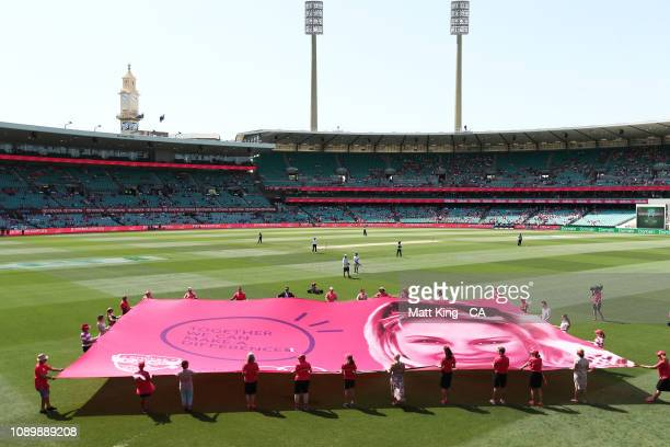 A gaint pink banner is unfurled on Jane McGrath Day during day three of the Fourth Test match in the series between Australia and India at Sydney...