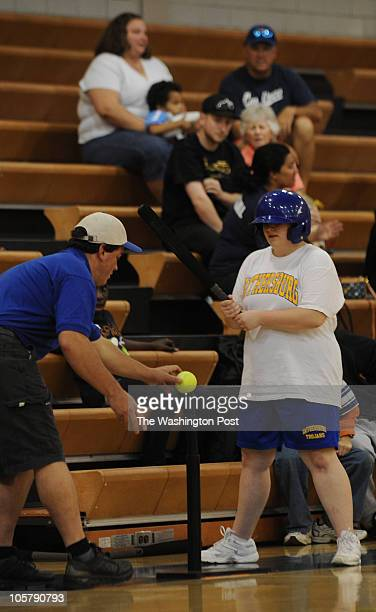 Gaithersburg coach Louis Levine left helps Amy Marshall get set to hit during the game at Gaithersburg High School on Saturday May 1 2010 A new...