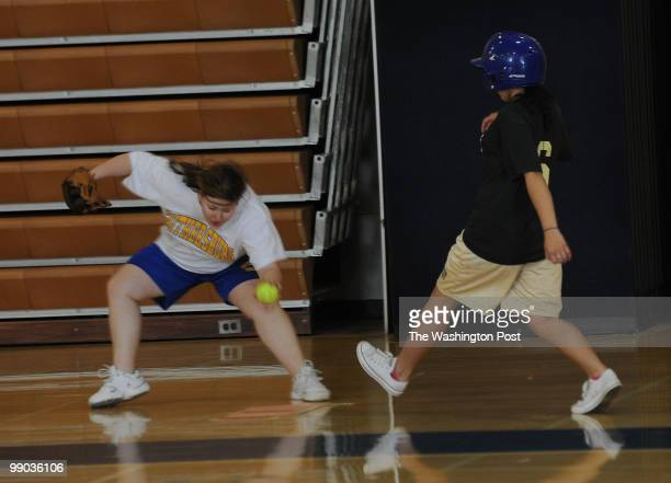 Gaithersburg High School student Amy Marshall left tags out Kennedy's Jenny Mendoza right during the corollary softball game at Gaithersburg High...