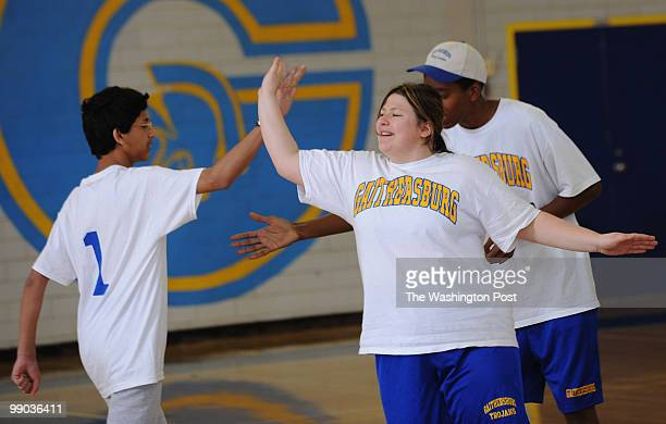 Gaithersburg High School student Amy Marshall right high fives her teammate Siram Soundararajan during team introductions before the corollary...