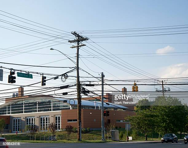 Gaithersburg Maryland 6302014 Power phone and data cable lines festoon the wooden telephone pole in front of the new firehouse Credit Mark Reinstein