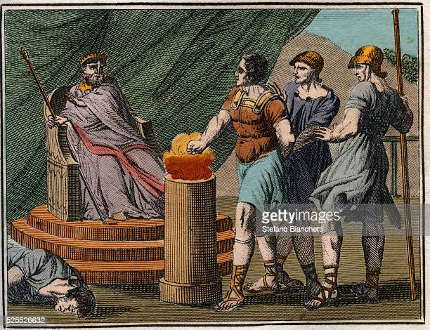 Gaius Mucius Scaevola thrust his hand into a nearby flame to prove his courage Amazed at his courage Porsenna freed him Engraving from ' Le Rollin de...