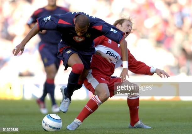 Gaizka Mendieta of Middlesbrough and Diomansky Kamara of Portsmouth challenge for the ball during the FA Barclaycard Premiership match between...