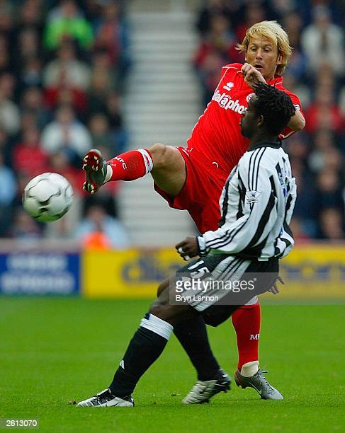 Gaizka Mendieta of Middlesbrough avoids a tackle from Olivier Bernard of Newcastle during the FA Barclaycard Premiership match between Middlesbrough...