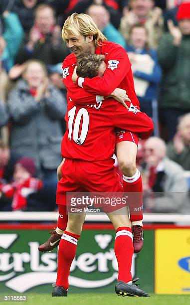 Gaizka Mendieta of Middlesbrough celebrates his goal with Juninho during the FA Barclaycard Premiership match between Middlesbrough and Birmingham...