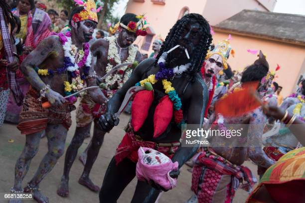 A gajan performer dressed up like a demon is performing with a fake human head in his hand in Burdwan India on 13 April 2017 quotGajanquot is one of...