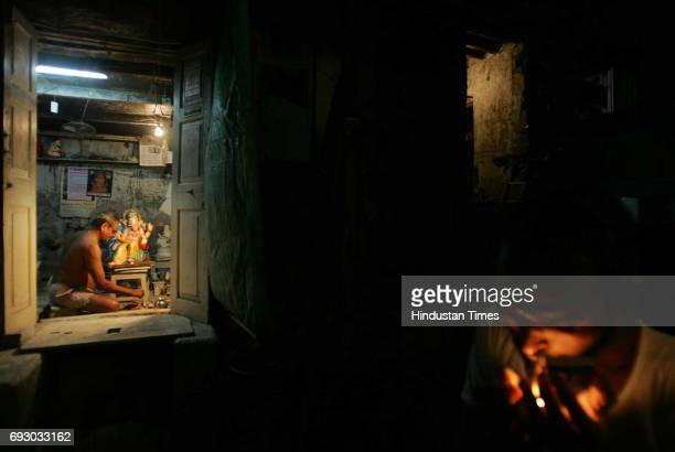 Gajanan Patkar Mill worker who lost his job three years ago paints a Ganpati idol in his house at Mazgaon. The building that he lives in, Prabhudas...