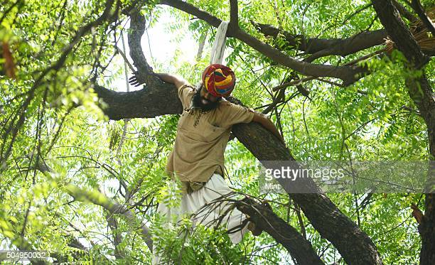 Gajendra Singh from Dossa in Rajasthan attempts suicide by hanging himself from a tree in the rally which was organised by AAP against the land bill...