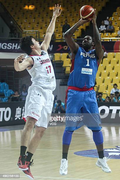 Gaku Arao of Japan vies with Andray Blatche of Philippines during the 2015 FIBA Asia Championship Second Round between Philippines and Japan at...