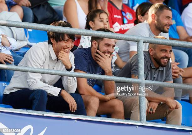 Gaku Shibasaki and Daniel Pacheco of Getafe watch from the stands prior to the La Liga match between Getafe and Villarreal at Coliseum Alfonso Perez...