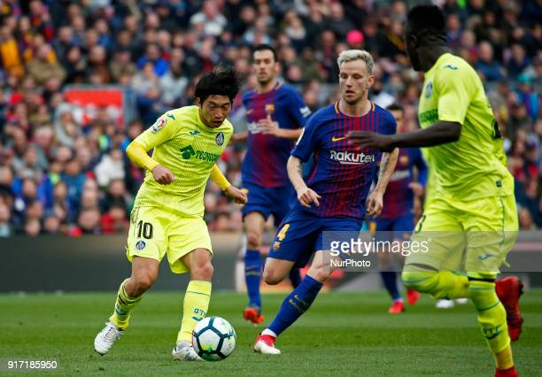Gaku Shibasaki and Ivan Rakitic during the match between FC Barcelona and Getafe CF for the round 23 of the Liga Santander played at the Camp Nou...
