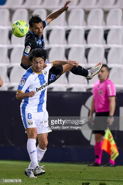 Gaku Shibasaki of CD Leganes battle for the ball with Joao Carvalho of UD Almeria during the La Liga Smartbank match between CD Leganes and UD...