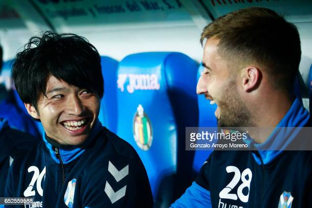 Gaku Shibasaki of CD Tenerife jokes with his teammates sitted on the bench prior to start the La Liga second league match between Getafe CF and...