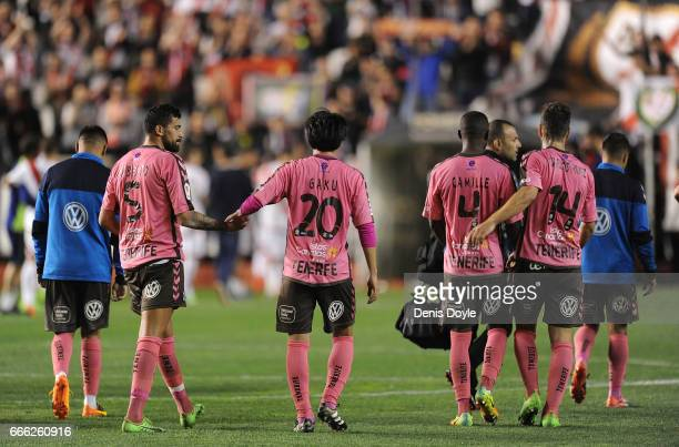 Gaku Shibasaki of CD Tenerife leaves the field withteammate Alberto after the La Liga Segunda Division match between Rayo Vallecano and CD Tenerife...
