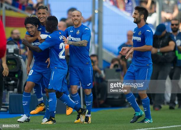 Gaku Shibasaki of Getafe celebrates with teammates after scoring his team's opening goal during the La Liga match between Getafe and Barcelona at...