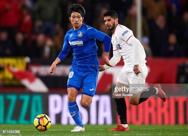 Gaku Shibasaki of Getafe CF being followed by Ever Banega of Sevilla FC during the warm up prior to the La Liga match between Sevilla and Getafe at...