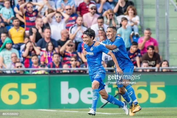 Gaku Shibasaki of Getafe CF celebrates after scoring his goal with his teammates during the La Liga 201718 match between Getafe CF and FC Barcelona...