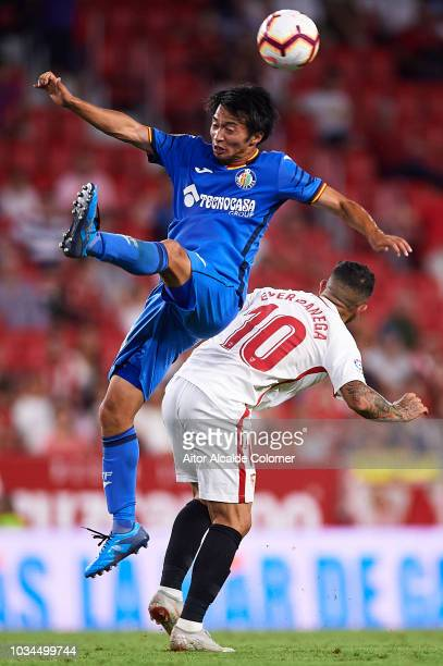 Gaku Shibasaki of Getafe CF competes for the ball with Ever Banega of Sevilla FC during the La Liga match between Sevilla FC and Getafe CF at Estadio...