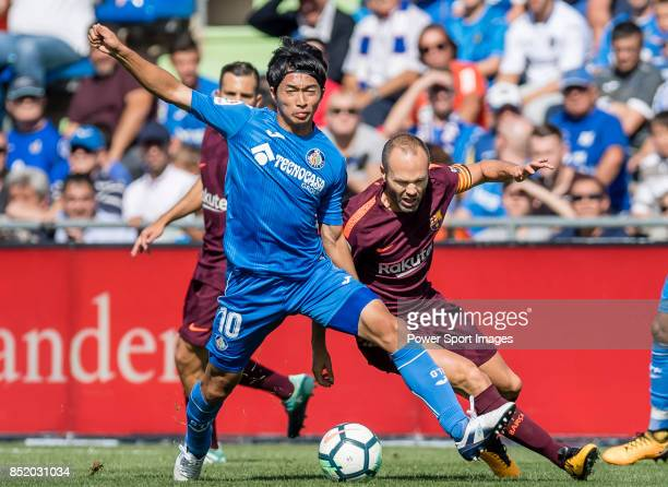 Gaku Shibasaki of Getafe CF fights for the ball with Andres Iniesta Lujan of FC Barcelona during the La Liga 201718 match between Getafe CF and FC...