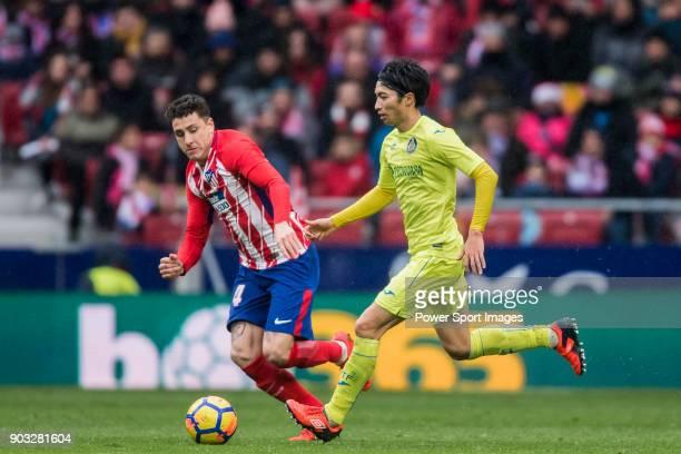 Gaku Shibasaki of Getafe CF fights for the ball with Jose Maria Gimenez de Vargas of Atletico de Madrid during the La Liga 201718 match between...