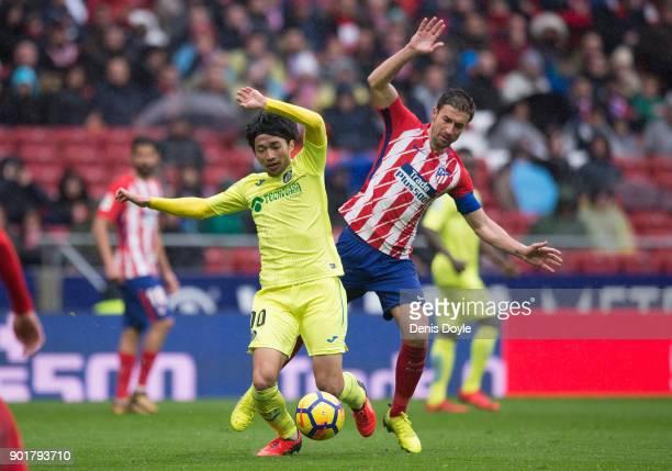 Gaku Shibasaki of Getafe is fouled by Gabi Fernandez of Atletico de Madridduring the La Liga match between Atletico Madrid and Getafe at estadio...