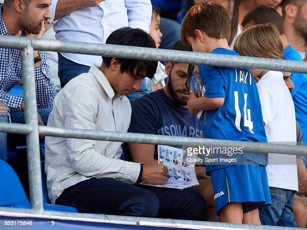 Gaku Shibasaki of Getafe signs autographs for fans during the La Liga match between Getafe and Villarreal at Coliseum Alfonso Perez on September 24...