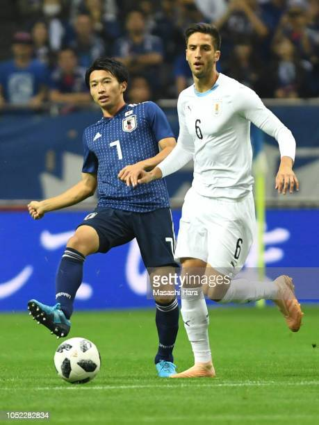 Gaku Shibasaki of Japan and Rodrigo Bentancur of Uruguay compete for the ball during the international friendly match between Japan and Uruguay at...