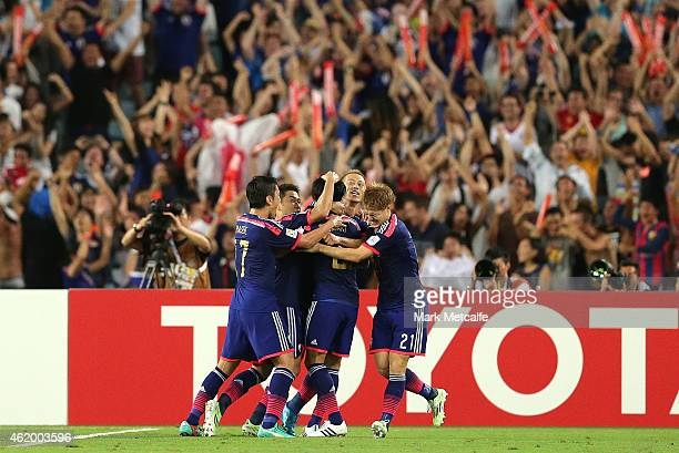 Gaku Shibasaki of Japan celebrates scoring a goal with team mates during the 2015 Asian Cup Quarter Final match between Japan and the United Arab...