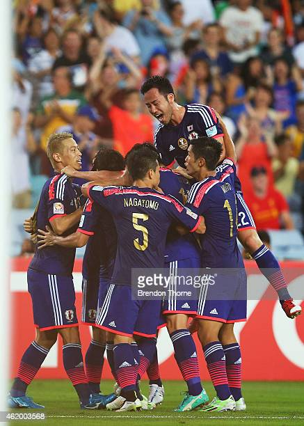 Gaku Shibasaki of Japan celebrates with team mates after scoring a goal during the 2015 Asian Cup Quarter Final match between Japan and the United...