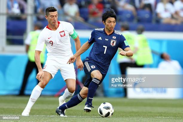 Gaku Shibasaki of Japan competes for the ball with Robert Lewandowski of Poland during the 2018 FIFA World Cup Russia group H match between Japan and...