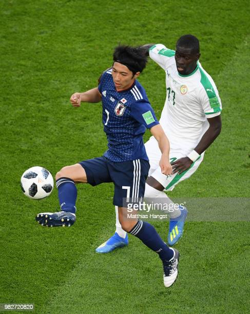 Gaku Shibasaki of Japan controls the ball under pressure from Pape Alioune Ndiaye of Senegal during the 2018 FIFA World Cup Russia group H match...