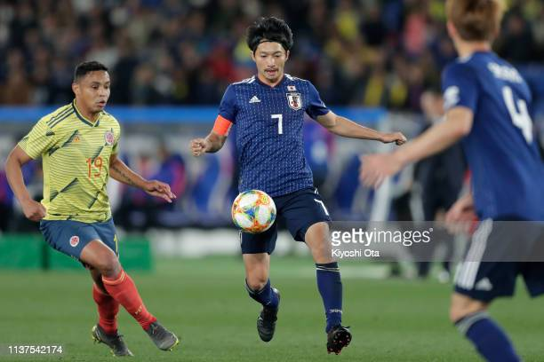 Gaku Shibasaki of Japan in action during the international friendly match between Japan and Colombia at Nissan Stadium on March 22 2019 in Yokohama...