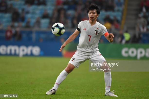 Gaku Shibasaki of Japan keeps the ball during the Copa America Brazil 2019 group C match between Uruguay and Japan at Arena do Gremio on June 20,...