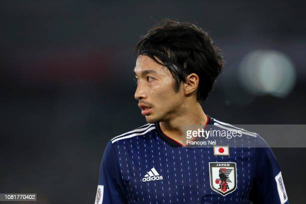 Gaku Shibasaki of Japan looks on during the AFC Asian Cup Group F match between Oman and Japan at Zayed Sports City Stadium on January 13, 2019 in...