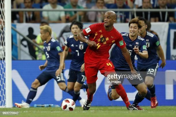 Gaku Shibasaki of Japan Vincent Kompany of Belgium Yuya Osako of Japan during the 2018 FIFA World Cup Russia round of 16 match between Belgium and...
