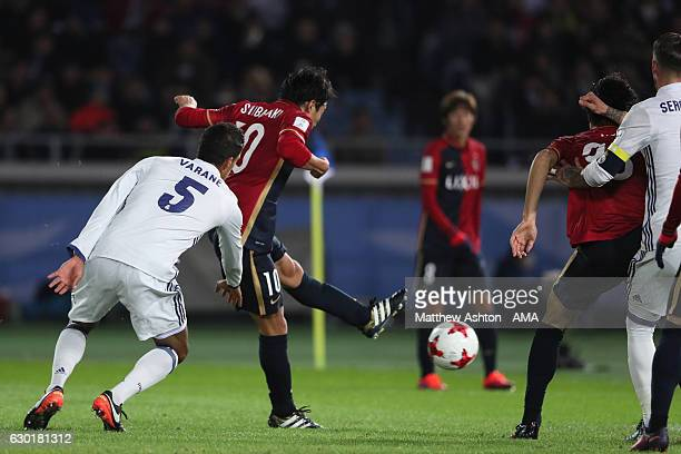Gaku Shibasaki of Kashima Antlers scores his team's first goal to make the score 11 during the FIFA Club World Cup final match between Real Madrid...