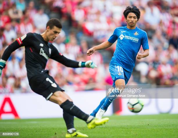 Gaku Shibasakiof Getafe CF competes for the ball with Kepa Arrizabalaga of Athletic Club during the La Liga match between Athletic Club and Getafe at...