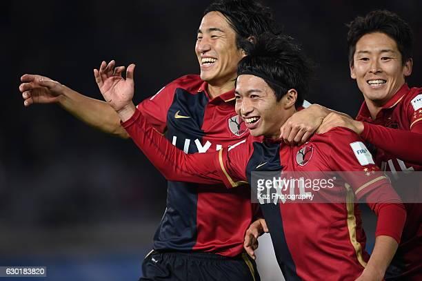 Gaku Shibazaki of Kashima Antlers celertes 2nd goal with Mu Kanazaki and Ryota Nagaki of Kashima Antlers during the FIFA Club World Cup final match...