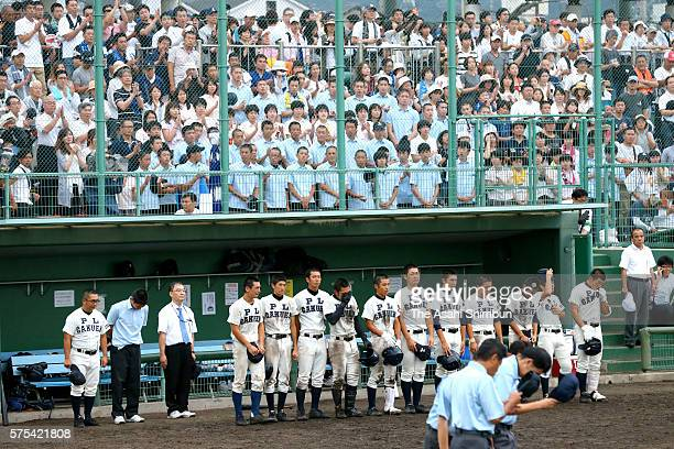 PL Gakuen baseball team members line up after their defeat by Higashiosaka Univ Kashiwara at the first round of the Japanese High School Baseball...