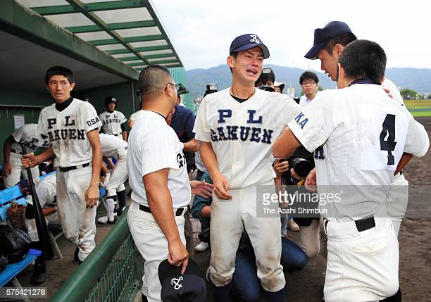 PL Gakuen baseball team members shed tears after their defeat by Higashiosaka Univ Kashiwara at the first round of the Japanese High School Baseball...