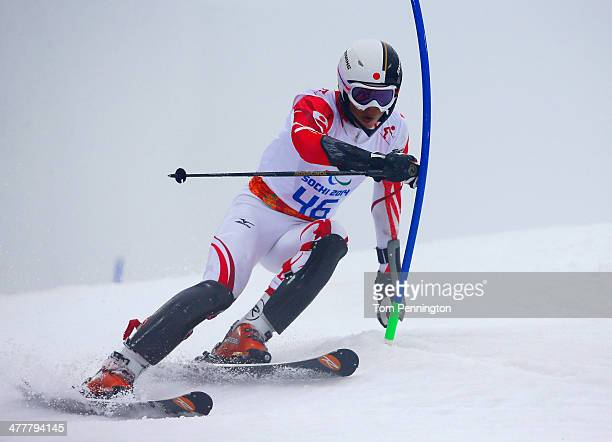 Gakuta Koike of Japan competes in the Men's SC Slalom Run 1 Standing during day four of Sochi 2014 Paralympic Winter Games at Rosa Khutor Alpine...