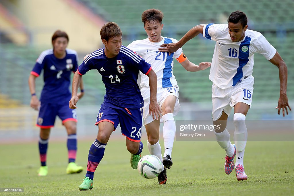 Gakuto Notsuda of Japan challenges Raposo De Matos Alexandre of Macau during the AFC U23 Championship Qualifier Group I match between Japan and Macau at Shah Alam Stadium on March 27, 2015 in Shah Alam, Malaysia.