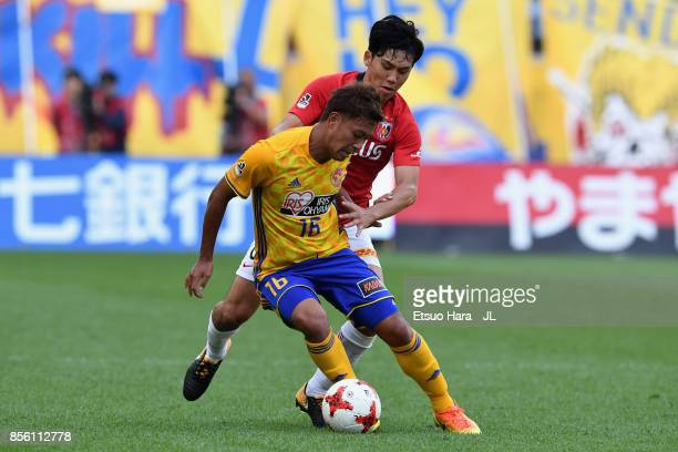 Gakuto Notsuda of Vegalta Sendai controls the ball under pressure of Wataru Endo of Urawa Red Diamonds during the JLeague J1 match between Vegalta...