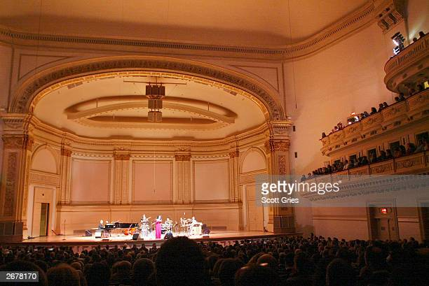 """Gal Costa performs during """"Autumn Samba: A Tribute to Antonio Carlos Jobim and Stan Getz"""" at Carnegie Hall October 28, 2003 in New York City."""
