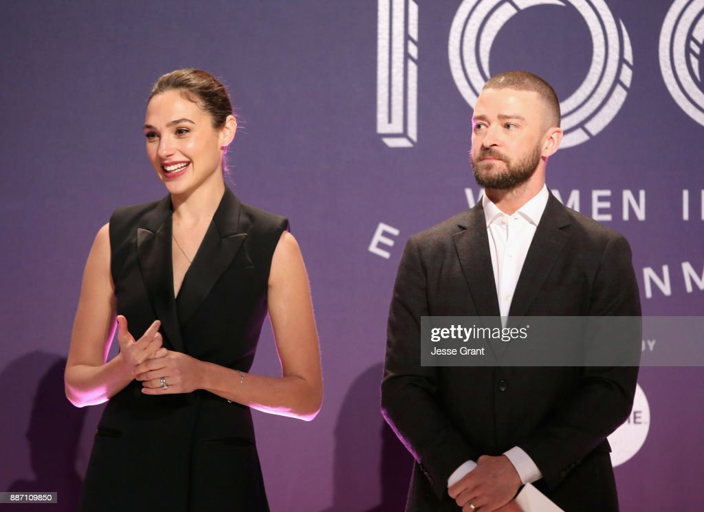 Gal Gadot (L) and Justin Timberlake speak onstage at The Hollywood Reporter's 2017 Women In Entertainment Breakfast at Milk Studios on December 6, 2017 in Los Angeles, California.