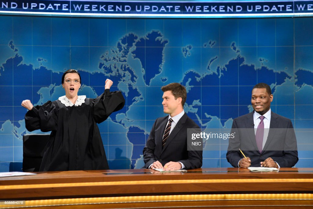 LIVE -- 'Gal Gadot' Episode 1727 -- Pictured: (l-r) Kate McKinnon as Ruth Bader Ginsburg Associate Justice of the Supreme Court of the United States, Colin Jost, Michael Che during 'Weekend Update' in Studio 8H on October 7, 2017 --